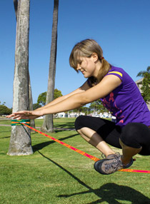 girl in static pose on Ladies Slackline