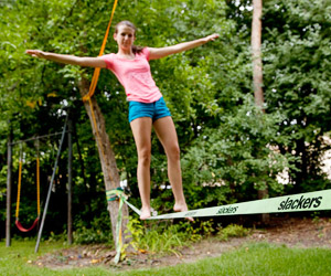 a girl balancing on the classic set